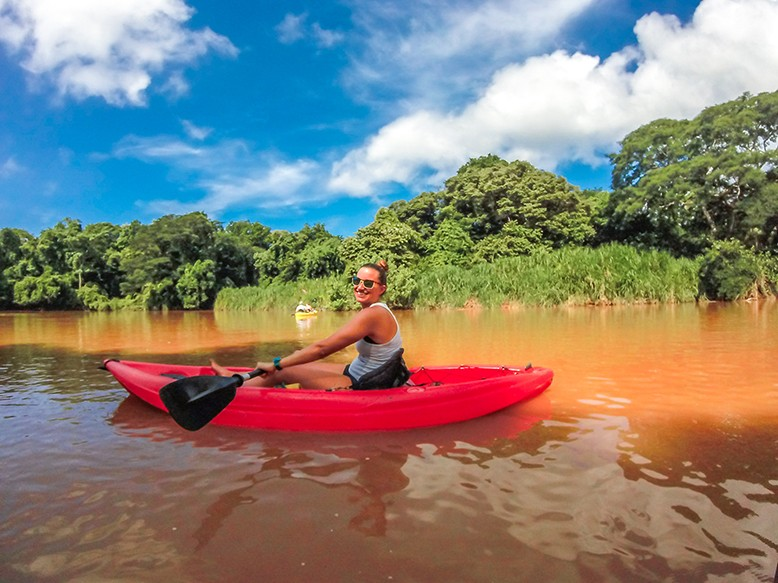 kayak in the rio ora samara beach yoga retreats